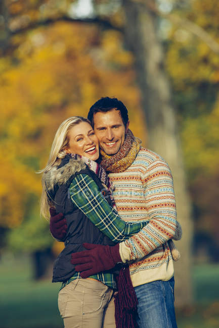 Portrait of couple embracing each other in a park — Stock Photo