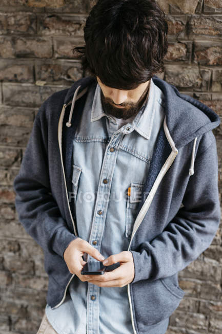 Young man using his smartphone — Stock Photo