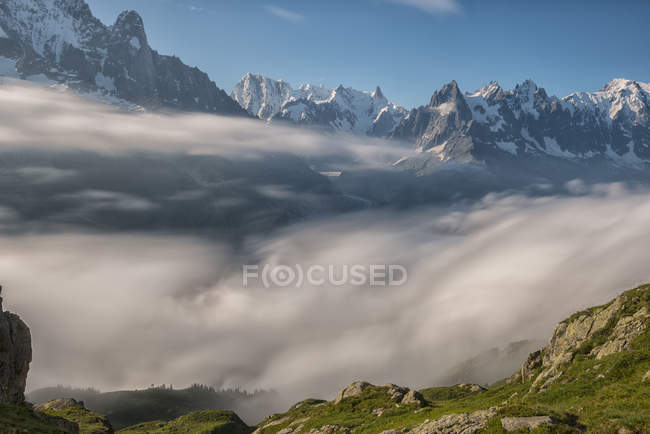 France, Mont Blanc, clouds on the Chamonix valley in front of Mont Blanc — Stock Photo