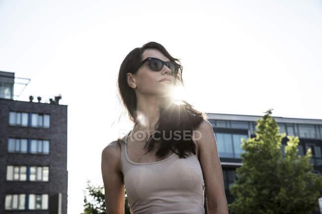 Dark-haired woman wearing sun glasses — Stock Photo