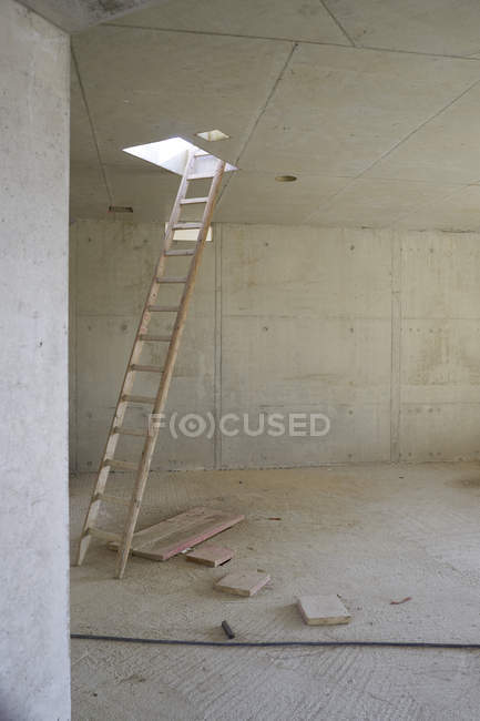 Ladder at skylight of an unfinished building — Stock Photo