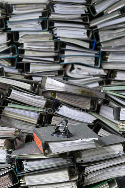 Piles of office files, folders and hole punch — Stock Photo