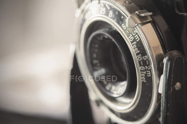 Old camera on blurred background , close-up — Stock Photo
