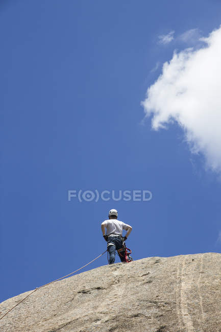Climber standing on the top of a rock — Stock Photo