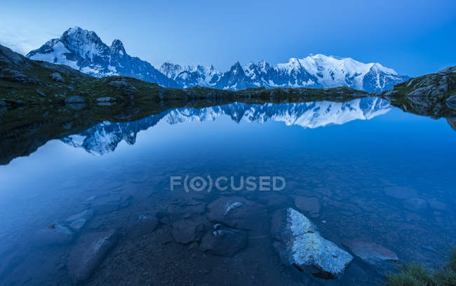 France, Mont Blanc, Lake Cheserys, Mont Blanc reflected in the lake at blue hour — Stock Photo