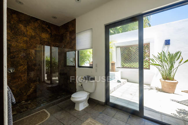 Toilet and shower in a residential home indoors — Stock Photo
