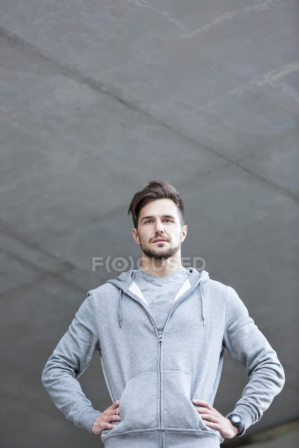 Man wearing hoodie looking at camera — Stock Photo