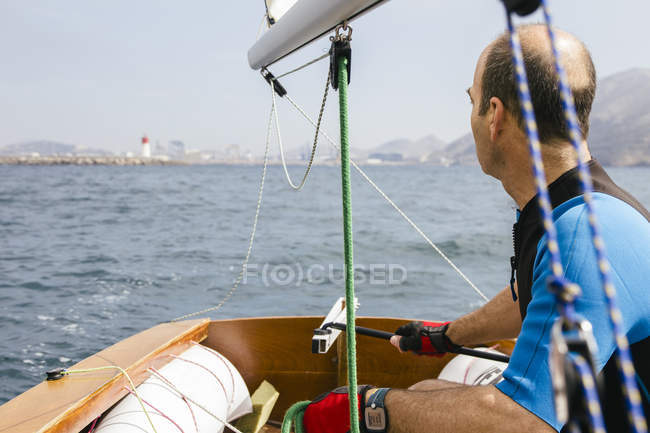 Man sailing with his sailboat at sea — Stock Photo
