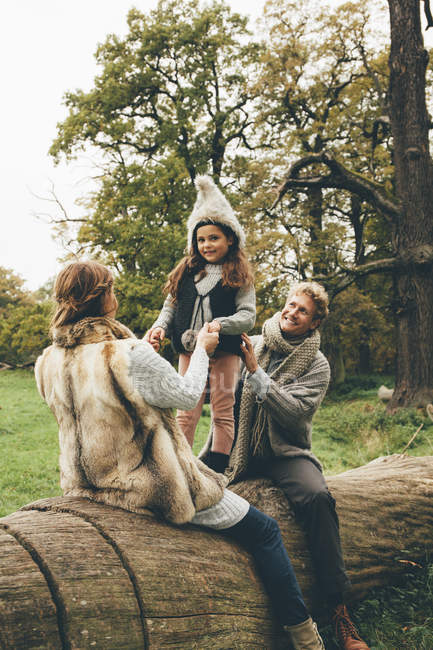 Happy family spending time together in an autumnal park — Stock Photo