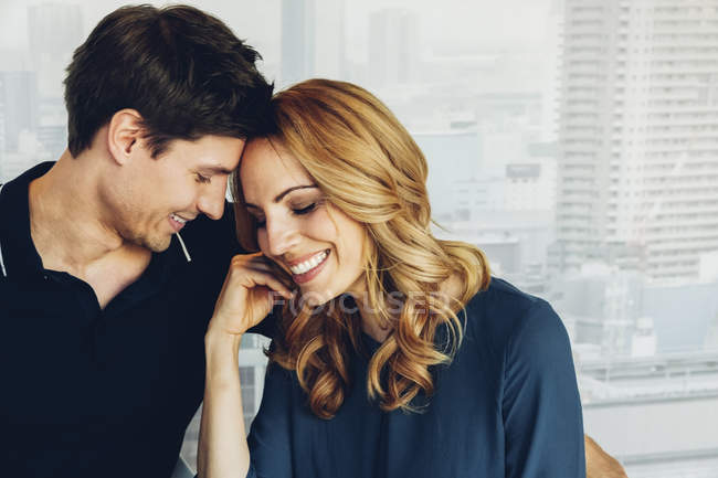 Smiling couple in love at home — Stock Photo