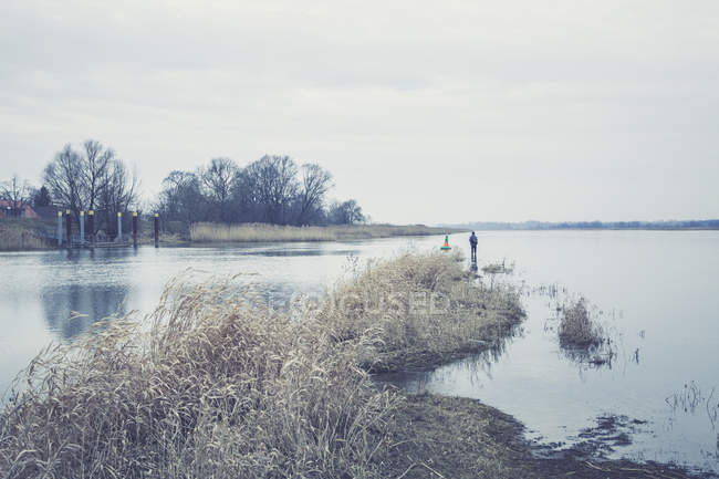 Germany, Brandenburg, Oderbruch, lonely angler at river Oder — Stock Photo