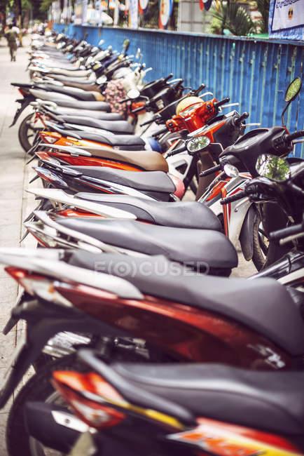 Vietnam, parking of motorbikes on roadside — Stock Photo