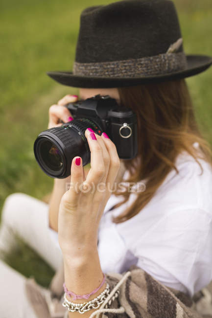 Young Woman photographing in nature — Stock Photo