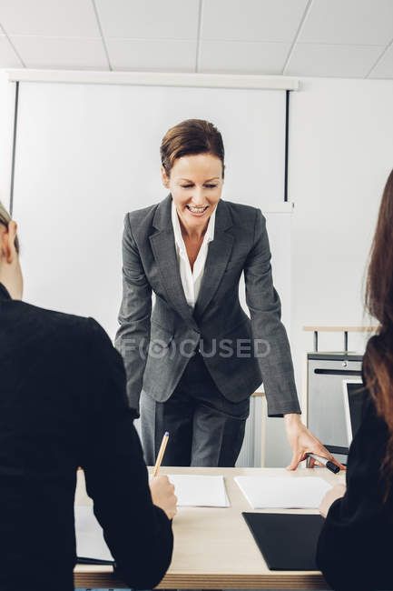 Mature woman giving business presentation — Stock Photo