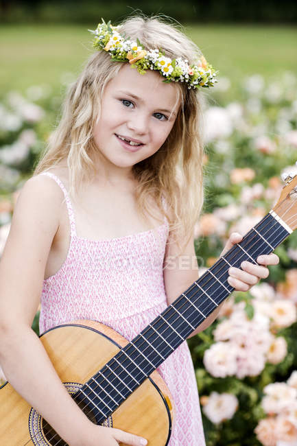 Smiling girl wearing floral wreath — Stock Photo