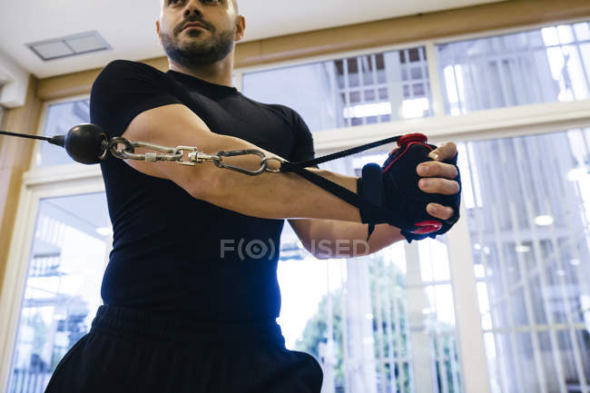 Portrait of Man exercising in a gym — Stock Photo