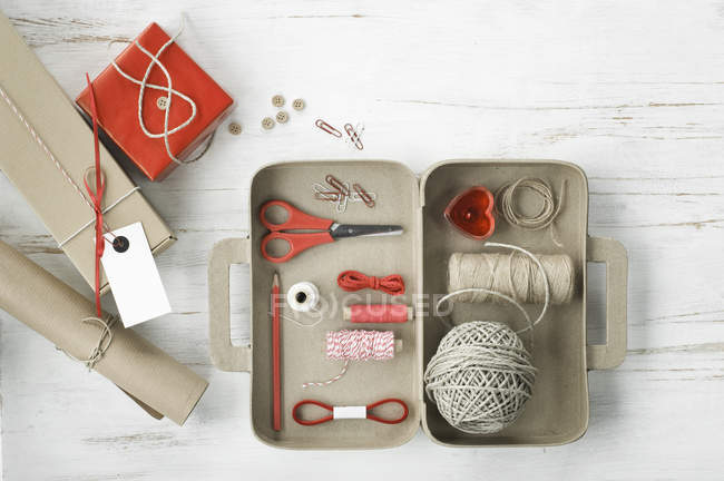 Tinkering utensils in a cardboard box shaped like a case — Stock Photo