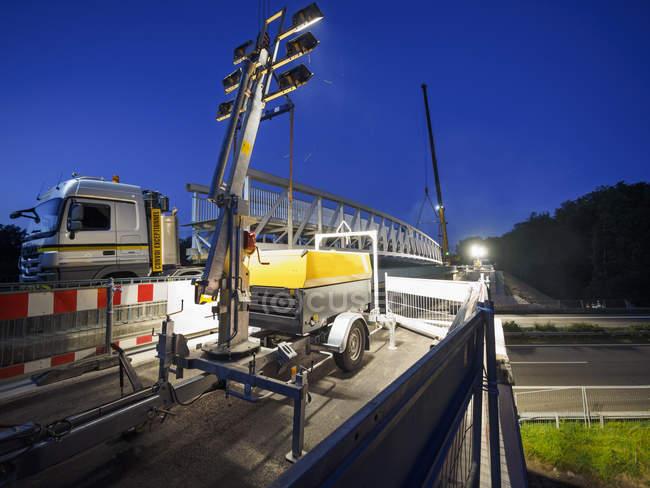 Construction of a pedestrian bridge at night — Stock Photo