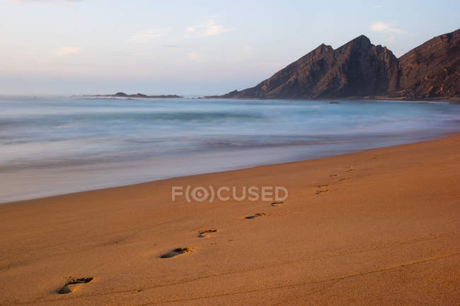 Bordeira beach with footprints — Stock Photo