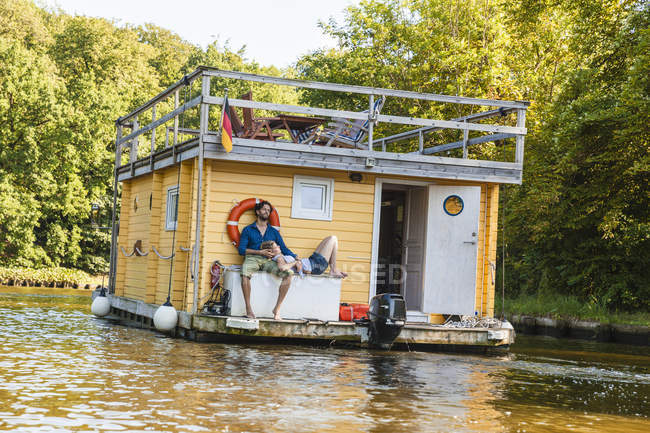 Couple having a trip on a house boat — Stock Photo