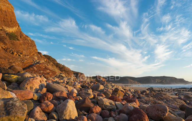 Seascape with stony beach — Stock Photo