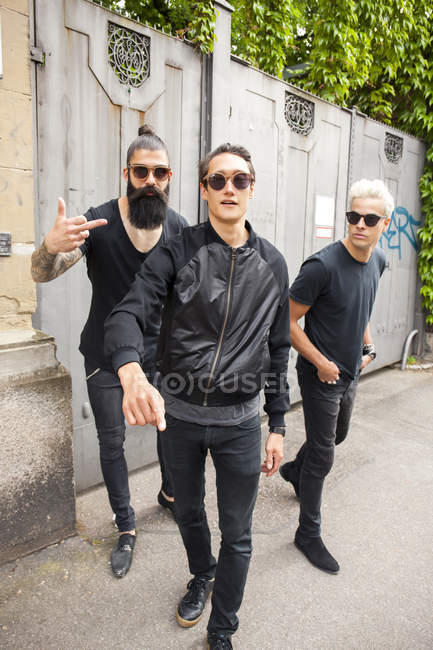 Portrait of three man wearing black clothing — Stock Photo