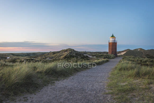 Footpath to lighthouse at sunset — Stock Photo