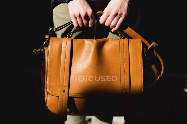 Woman's hands holding leather bag, close-up — Stock Photo