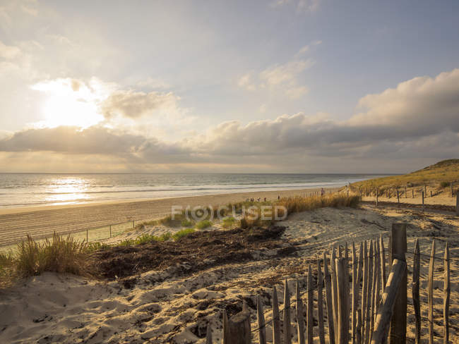 France, Contis-Plage, view to the beach at twilight over water — Stock Photo