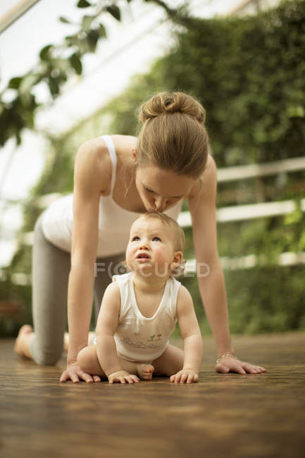 Woman kissing her little daughter — Stock Photo