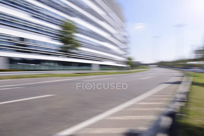Blurred office building with empty street in the foreground, Germany — Stock Photo