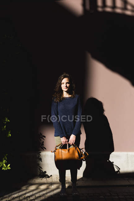 Stylish Woman with leather bag — Stock Photo