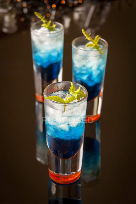 Cocktail with blue curacao liqueur — Stock Photo