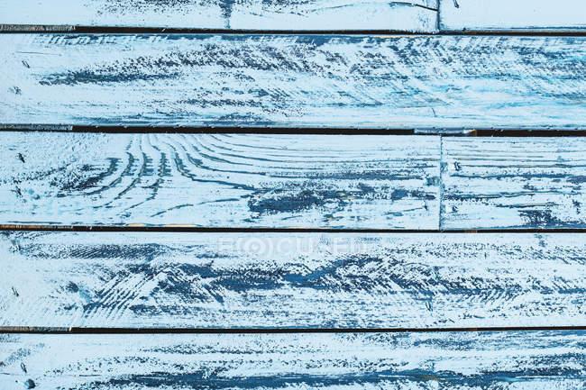 Wooden texture, blue wooden desks — Stock Photo