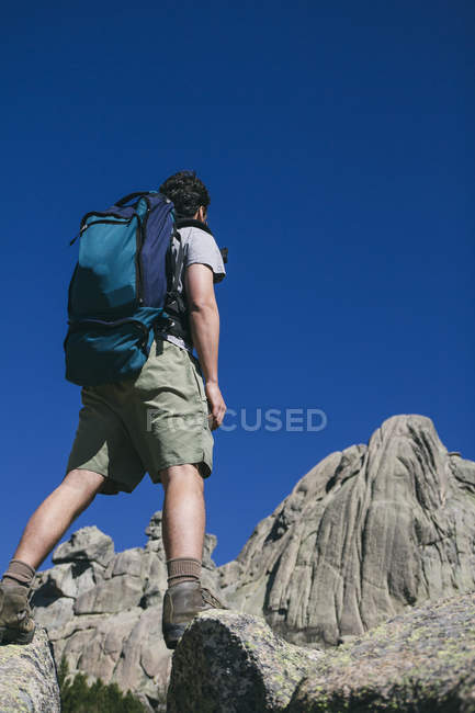 Spain, hiker with a backpack in Regional Park La Pedriza — Stock Photo