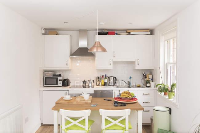 Cozy design of kitchen interior in light colors — Stock Photo