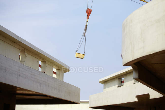 Crane lifting container on construction site — Stock Photo
