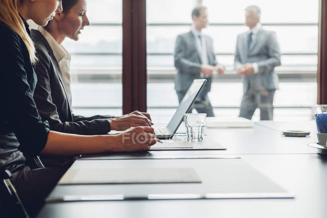 Businesswomen working with laptop at table in office — Stock Photo