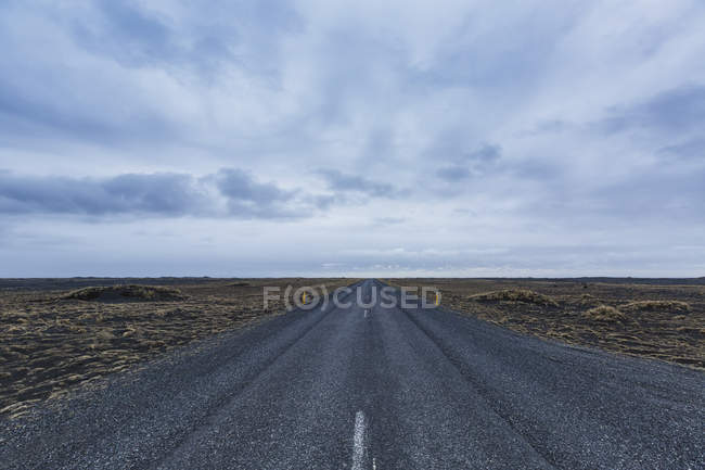 Iceland, street road and clouds during daytime — Stock Photo