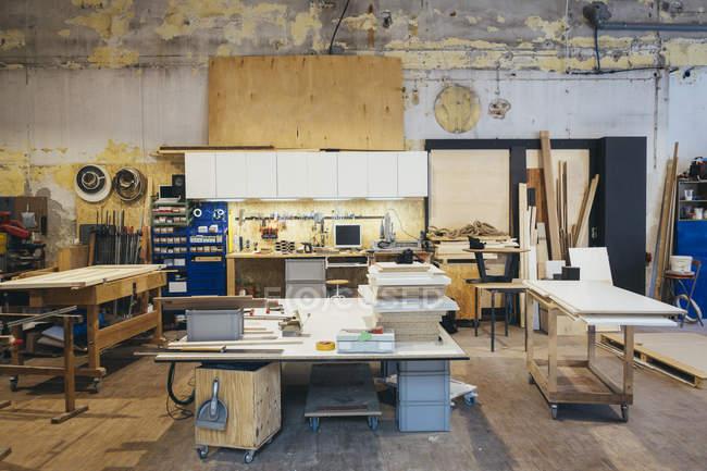 Interior of a empty carpenter workshop with workbench ...