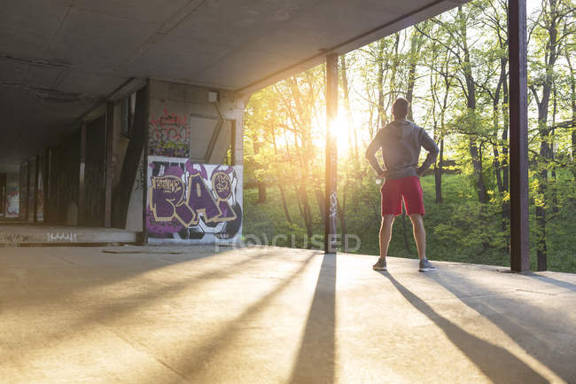 Young athletic man standing at underpass — Stock Photo