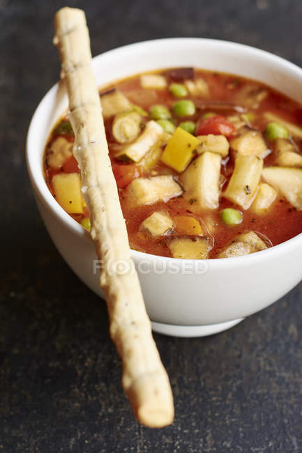 Closeup of bowl with minestrone soup on table — Stock Photo