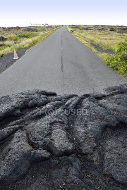 USA, Hawaii, Big Island, Volcanoes National Park, congealed lava on the lane of Chain of Craters Road — Stock Photo