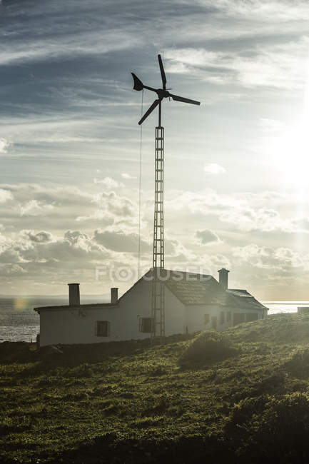 Spain, Andalusia, Tarifa, house with wind wheel — Stock Photo