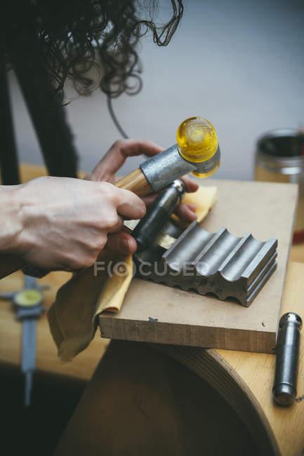 Goldsmith working on wedding ring work piece — Stock Photo