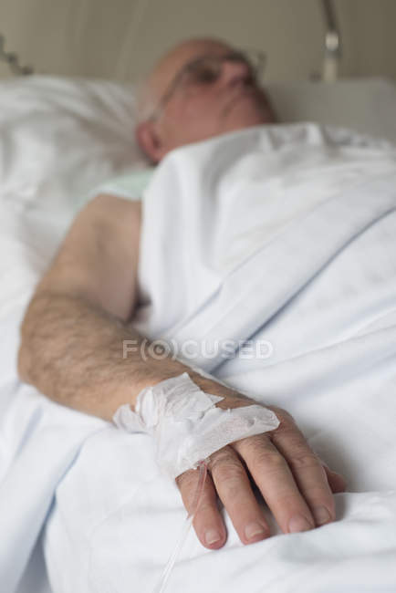 Hand of a senior man after surgery — Stock Photo
