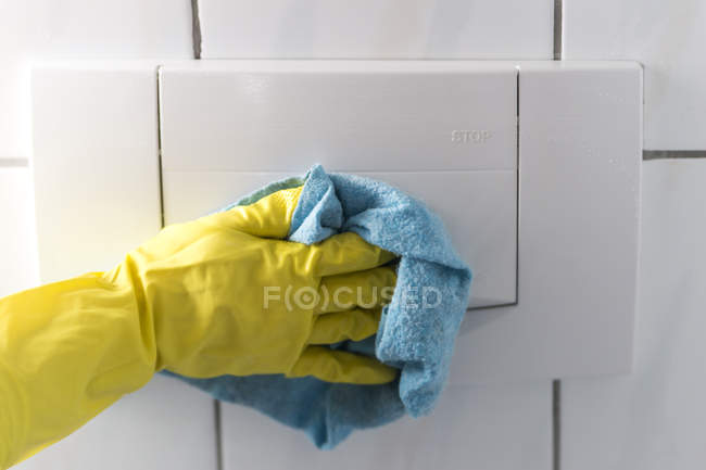 Woman's hand cleaning toilet — Stock Photo