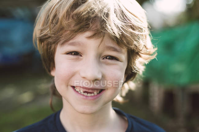 Portrait of blond boy with big smile looking at camera — Stock Photo