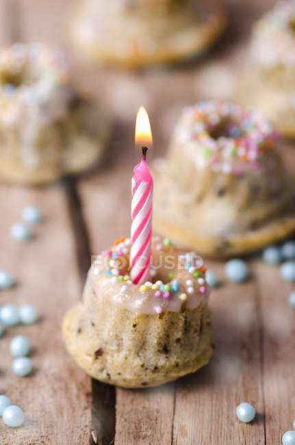 Birthday cake with lighted candle — Stock Photo