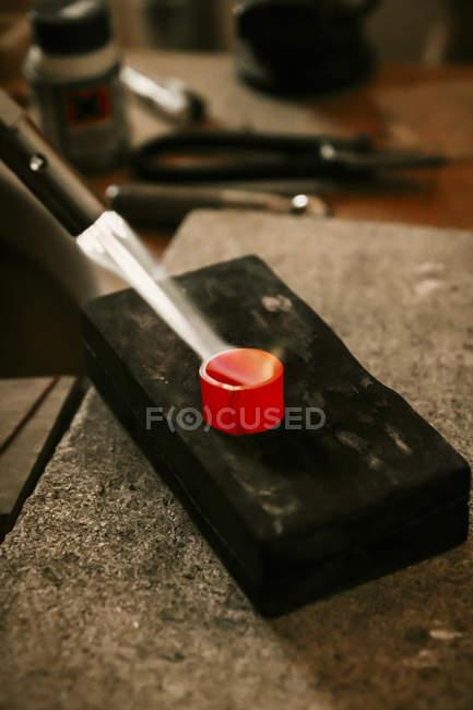 Goldsmith working with Bunsen burner on workpiece — Stock Photo